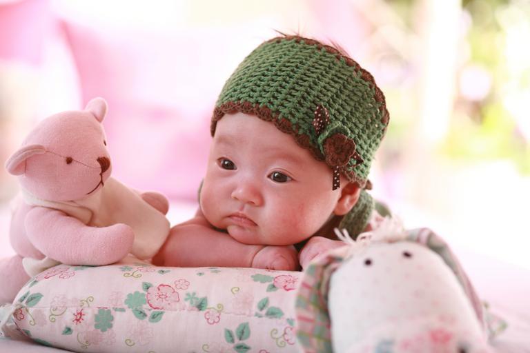 miminko na polštáři